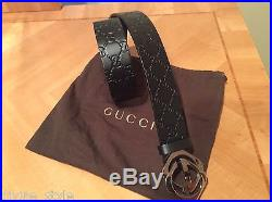 ICONIC CHIC GUCCI brown imprinted GG leather belt withlarge logo buckle closure